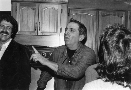 Image above/right: Herb Gutman holding forth at a dinner party in his Nyack, New York, kitchen, circa 1982; Steve Brier is to his right.